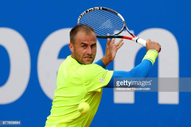 Marius Copil of Rumania plays the ball against Roberto Bautista Agut of Spain during their 2 round match of the 102 BMW Open by FWU at Iphitos tennis...