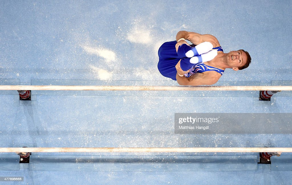 Marius Daniel Berbecar of Romania competes during the Men's Gymnastics Parallel Bars final on day eight of the Baku 2015 European Games at the...