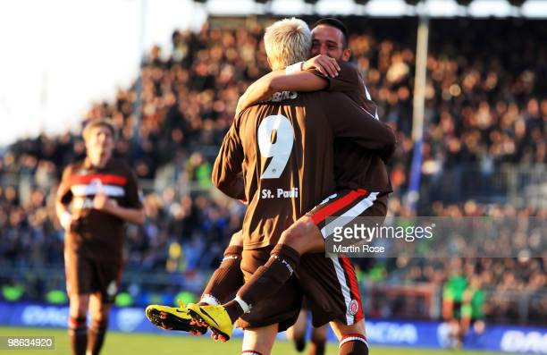 Marius Ebbers of St Pauli celebrates with team mate Deniz Naki after scoring his team's 4th goal during the Second Bundesliga match between FC St...