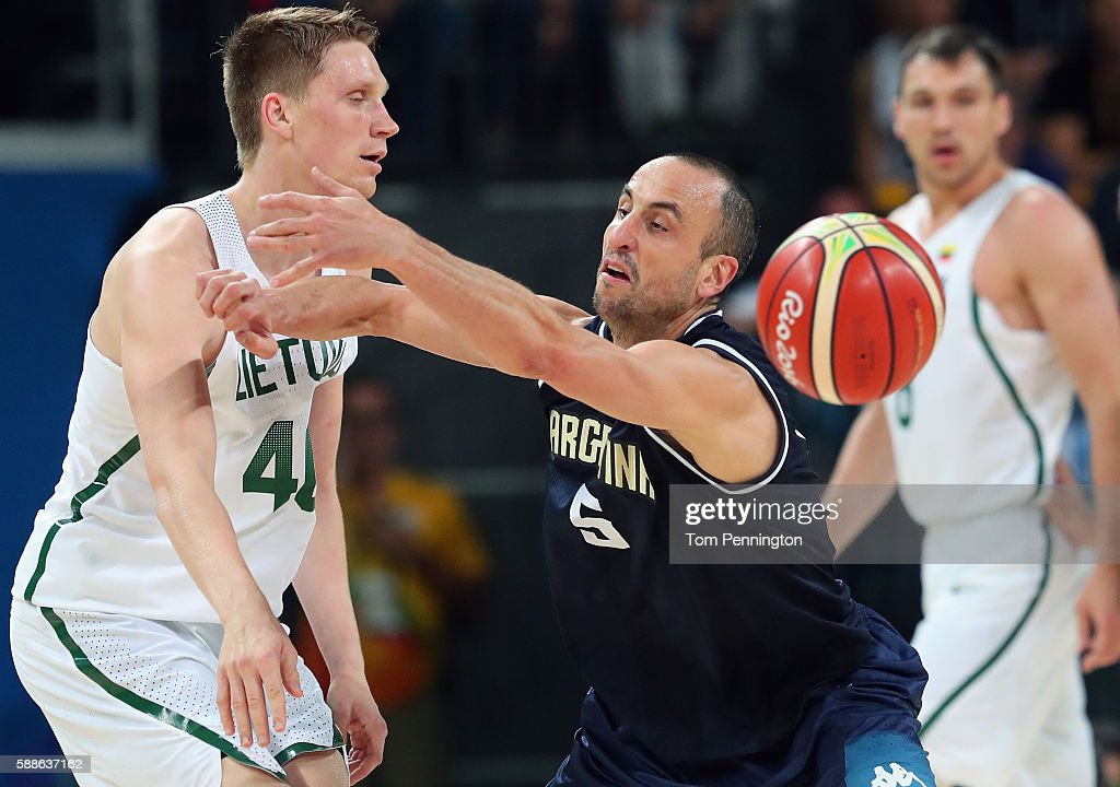 Marius Grigonis of Lithuania passes the ball against Manu Ginobili of Argentina during the Men's Basketball Preliminary Round Group B Lithuania vs...