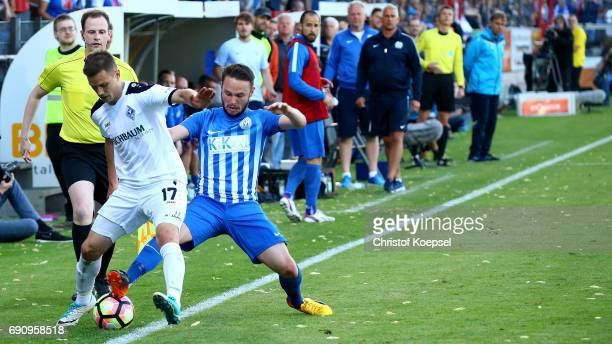 Marius Kleinsorge of Meppen challenges Gianluca Korte of Mannheim during the Relegation Regionalliga Play Off second leg match at Hensch Arena on May...