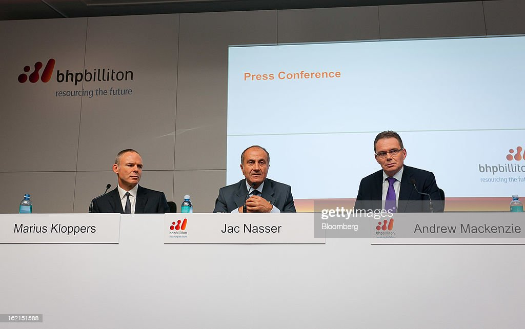 Marius Kloppers, chief executive officer of BHP Billiton Ltd., from left, Jacques 'Jac' Nasser, chairman, and Andrew Mackenzie, chief executive officer for non-ferrous, attend a news conference in Sydney, Australia, on Wednesday, Feb. 20, 2013. BHP Billiton, the world's biggest mining company, named its copper unit head Andrew Mackenzie as chief executive officer to succeed Marius Kloppers before reporting a 58 percent decline in first-half profit. Photographer: Ian Waldie/Bloomberg via Getty Images Marius Kloppers; Jac Nasser; Andrew Mackenzie