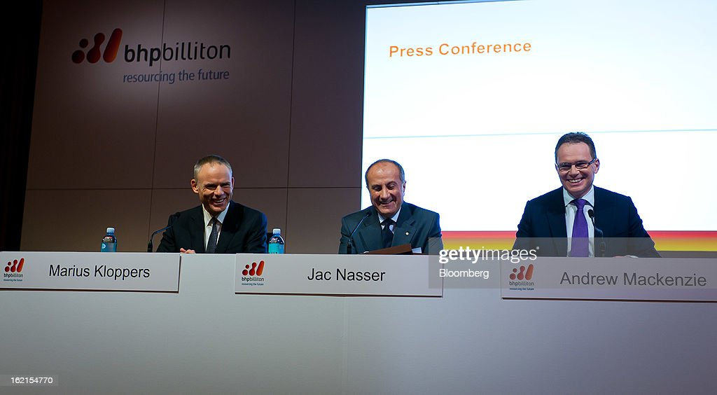 Marius Kloppers, chief executive officer of BHP Billiton Ltd., from left, Jacques 'Jac' Nasser, chairman, and Andrew Mackenzie, chief executive officer for non-ferrous, smile during a news conference in Sydney, Australia, on Wednesday, Feb. 20, 2013. BHP Billiton, the world's biggest mining company, named its copper unit head Andrew Mackenzie as chief executive officer to succeed Marius Kloppers before reporting a 58 percent decline in first-half profit. Photographer: Ian Waldie/Bloomberg via Getty Images Marius Kloppers; Jac Nasser; Andrew Mackenzie