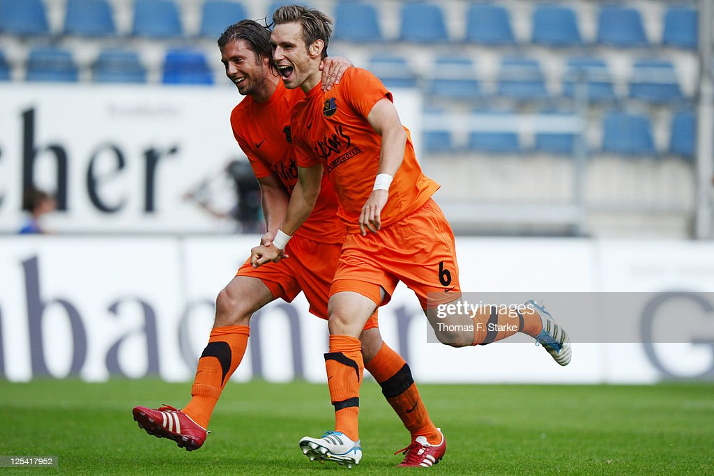 Marius Laux (L) and Christian Eggert of Saarbruecken celebrate during the Third League match between Arminia Bielefeld and 1. FC Saarbruecken at the Schueco Arena on September 17, 2011 in Bielefeld, Germany.
