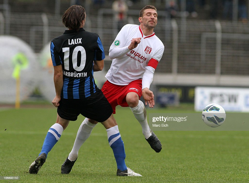 Marius Laux of Saarbruecken (L) challenges Maik Wagefeld of Halle (R) during the Third League match between 1. FC Saarbruecken and Hallescher FC at Ludwigsparkstadion on November 24, 2012 in Saarbruecken, Germany.