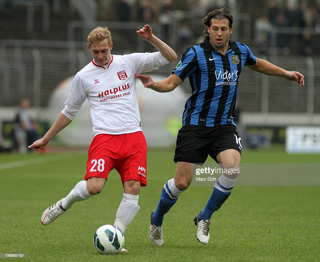 Marius Laux of Saarbruecken (R) challenges Soeren Eismann of Halle (L) during the Third League match between 1. FC Saarbruecken and Hallescher FC at Ludwigsparkstadion on November 24, 2012 in Saarbruecken, Germany.