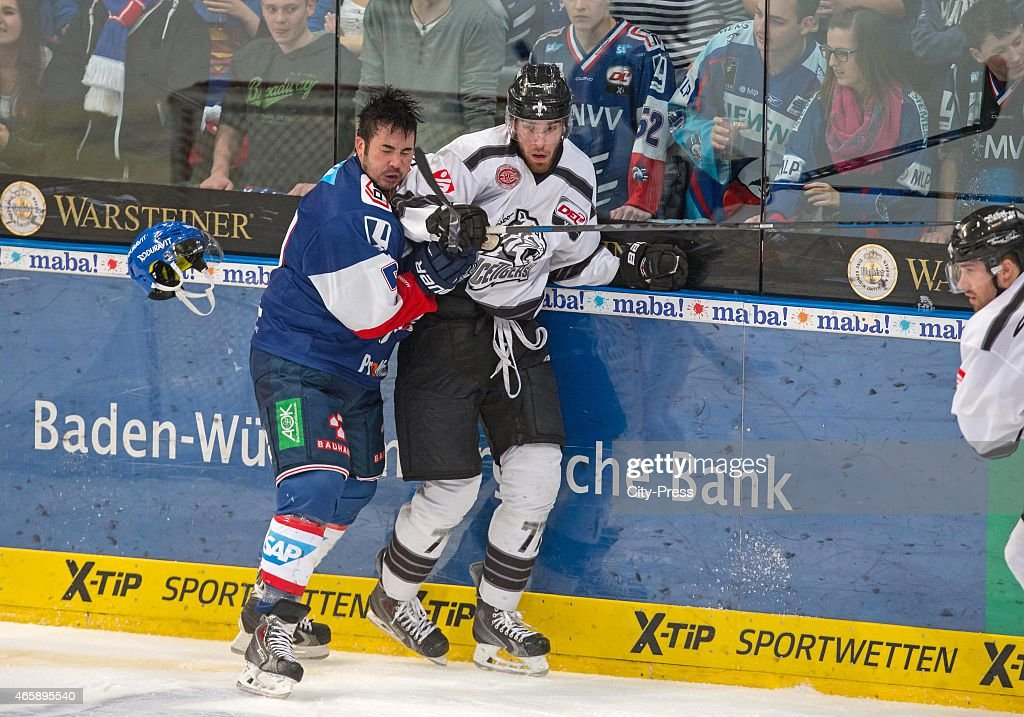 marius moechel of the thomas sabo ice tigers nuernberg punches jochen hecht of the adler. Black Bedroom Furniture Sets. Home Design Ideas
