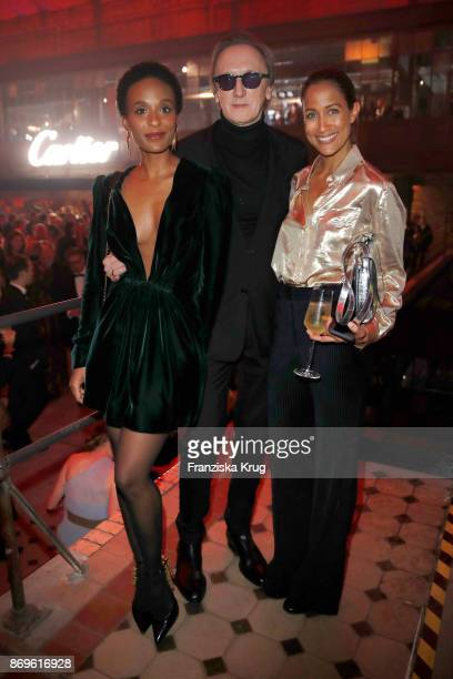 Marius MuellerWesternhagen his partner Lindiwe Suttle and Rabea Schif attend the When the Ordinary becomes Precious #CartierParty at Old Power...