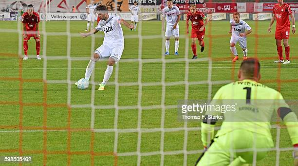 Marius Sowislo misses to score a penalty against goalkeeper Johannes Brinkies during the Third League match between FSV Zwickau and 1 FC Magdeburg at...