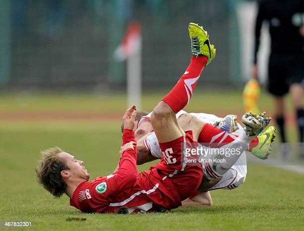 Marius Strangl of Erfurt and Henrik Ernst of Leipzig in action during the Third league match between RotWeiss Erfurt and RB Leipzig at Steigerwald...