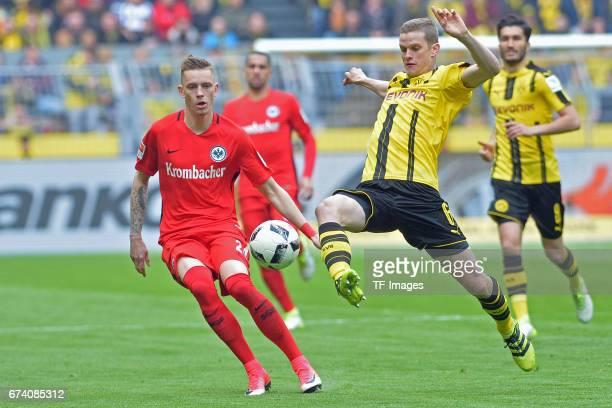 Marius Wolf of Frankfurt and Sven Bender of Dortmund battle for the ball during the Bundesliga match between Borussia Dortmund and Eintracht...
