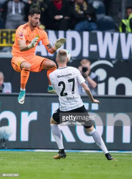 Marius Wolf of Frankfurt tries to score against goalkeeper Roman Buerki of Dortmund during the Bundesliga match between Eintracht Frankfurt and...