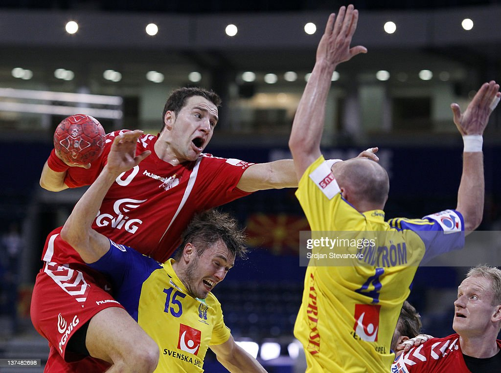 Mariusz Jurkiewicz (L) of Poland vies with Jonas Larholm (C) and Henrik Lundstrom (R) of Sweden, during the Men's European Handball Championship 2012 group 1 match between Poland and Sweden at Belgrade Arena Hall on January 21, 2011 in Belgrade, Serbia.
