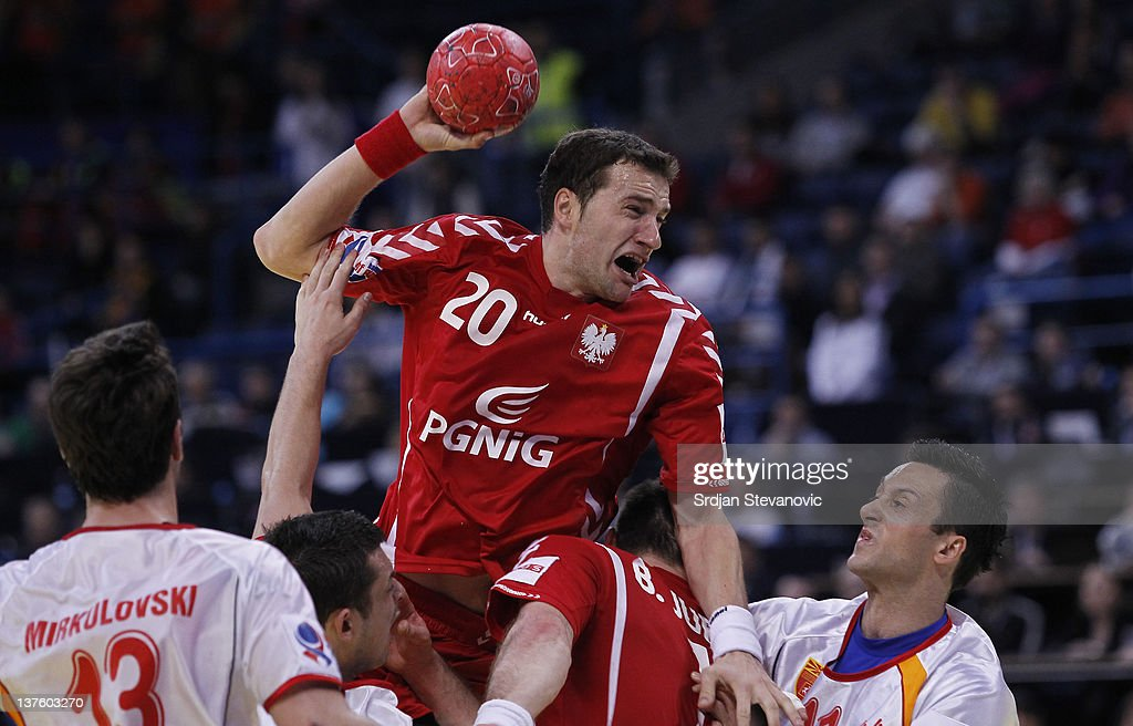Mariusz Jurkiewiczi (C) of Poland competes with Velko Markoski (R) of Macedonia, during the Men's European Handball Championship 2012 second round group one, match between Poland and Macedonia, at Arena Hall on January 23, 2012 in Belgrade, Serbia.