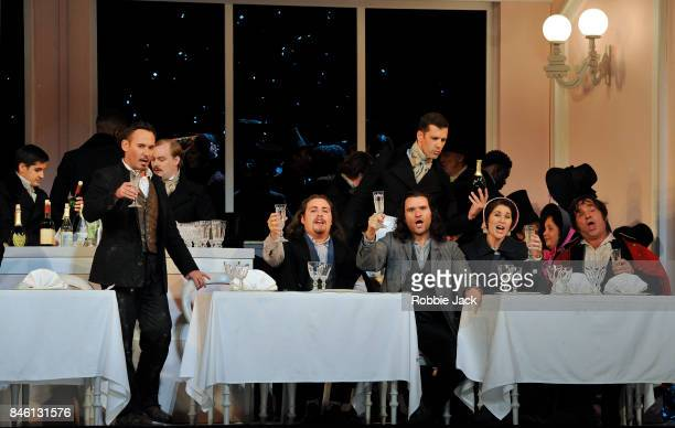 Mariusz Kwiecien as Marcello Florian Sempey as Schaunard Michael Fabiano as RodolfoNicole Car as Mimi and Luca Tittoto as Colline with artists of the...