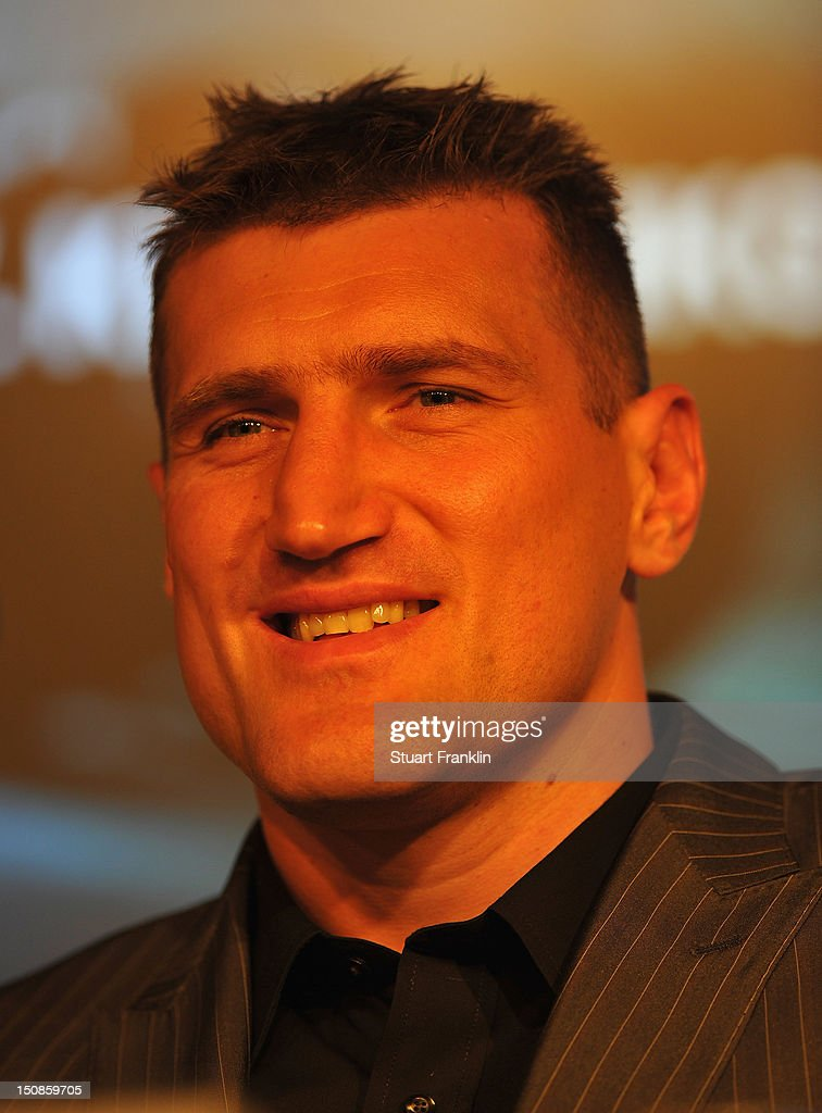 Mariusz Wach of Poland ponders during a press conference with Wladimir Klitschko and Mariusz Wach ahead of their upcoming boxing fight at O2 World on...