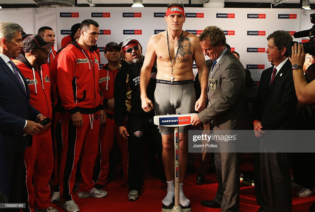 Mariusz Wach of Poland poses during the weigh in at Karstadt Sport on November 9 2012 in Hamburg Germany The WBA IBF WBO and IBO heavy weight title...