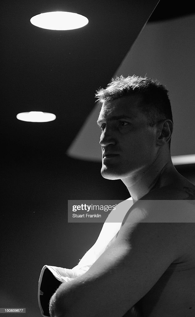 Mariusz Wach of Poland poses for a picture after a press conference with Wladimir Klitschko and Mariusz Wach ahead of their upcoming boxing fight at...