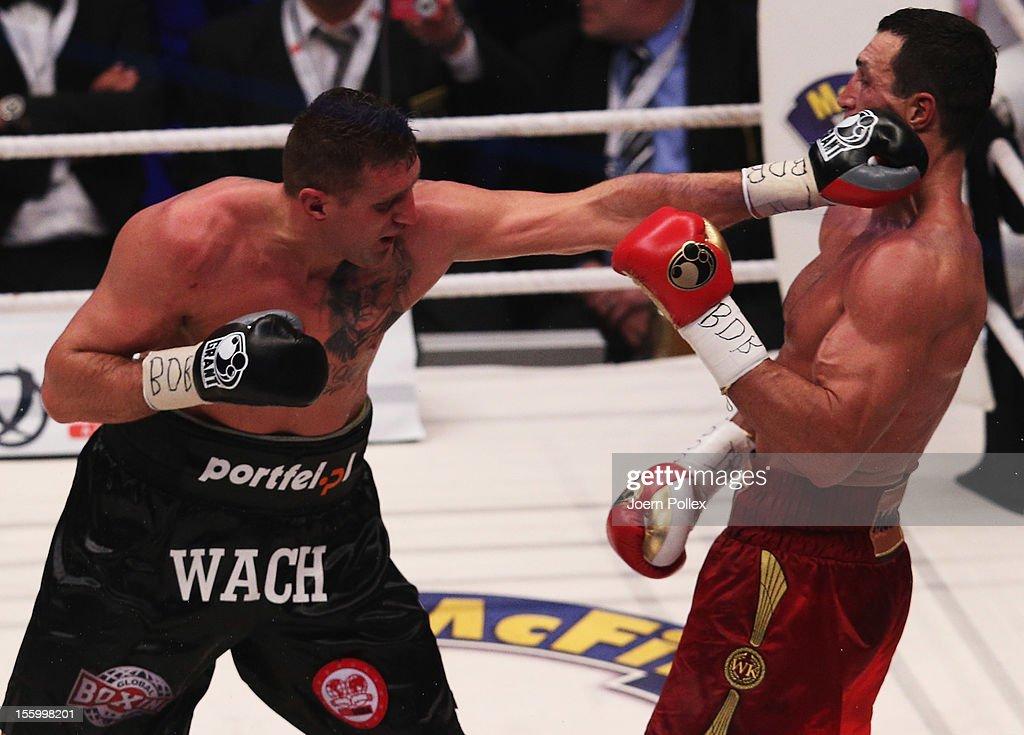 Mariusz Wach of Poland punches Wladimir Klitschko of Ukraine during the WBA IBF WBO and IBOheavy weight title fight between Wladimir Klitschko of...