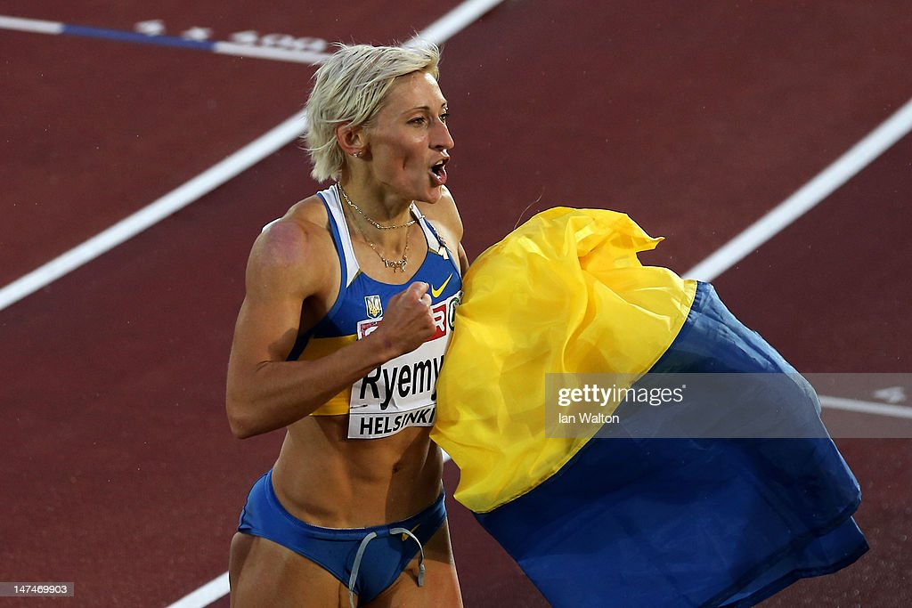 <a gi-track='captionPersonalityLinkClicked' href=/galleries/search?phrase=Mariya+Ryemyen&family=editorial&specificpeople=6837087 ng-click='$event.stopPropagation()'>Mariya Ryemyen</a> of Ukraine celebrates winning the Women's 200 Metres Final during day four of the 21st European Athletics Championships at the Olympic Stadium on June 30, 2012 in Helsinki, Finland.
