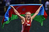 Mariya Stadnyk of Azerbaijan celebrates after defeating Elitsa Yankova of Bulgaria in the Women's Freestyle 48kg Wrestling Final during day three of...