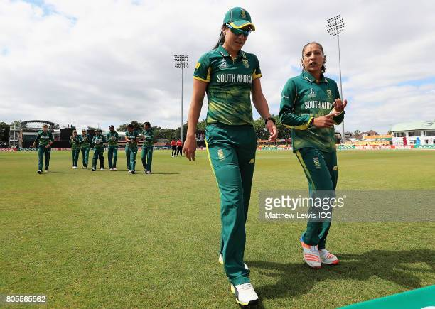 Marizanne Kapp and Shabnim Ismail of South Africa walk off after the first innings against the West Indies during the ICC Women's World Cup 2017...
