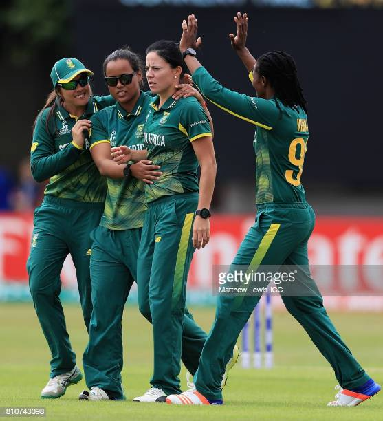 Marizanne Kapp of SoutH Africa is congratulated on the wicket of Smriti Mandhana of India after she was caught by Shabnim Ismail during the ICC...