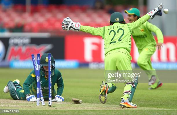 Marizanne Kapp of South Africa lies on the ground after being run out by Sidra Nawaz of Pakistan during the ICC Women's World Cup match between...
