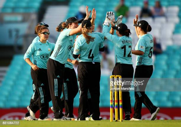 Marizanne Kapp of Surrey celebrates with her teammates after dismissing Chamari Athapaththu of Yorkshire during the Kia Super League match between...
