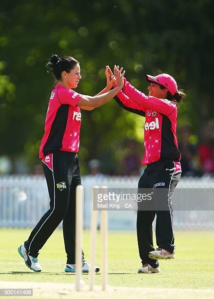 Marizanne Kapp of the Sixers celebrates with Lisa Sthalekar of the Sixers after taking the wicket of Rachel Haynes of the Thunder during the Women's...