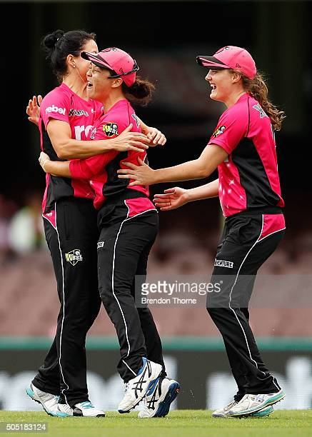 Marizanne Kapp of the Sixers celebrates with team mate Lauren Smith after claiming the wicket of Rachael Haynes of the Thunder during the Women's Big...