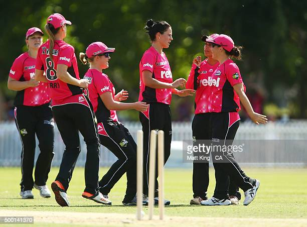 Marizanne Kapp of the Sixers celebrates with team mates after taking the wicket of Rachel Haynes of the Thunder during the Women's Big Bash League...