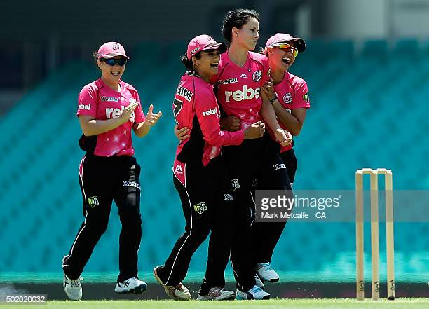 Marizanne Kapp of the Sixers celebrates with team mates after taking the wicket of Elyse Villani of the Scorchers during the Women's Big Bash League...