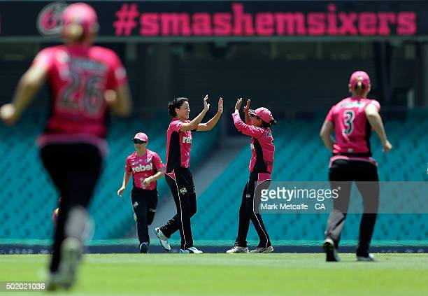 Marizanne Kapp of the Sixers celebrates with team mates after taking the wicket of Nicole Bolton of the Scorchers during the Women's Big Bash League...