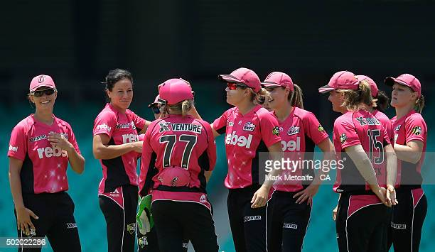 Marizanne Kapp of the Sixers celebrates with team mates after taking the wicket of Emma Biss of the Scorchers during the Women's Big Bash League...