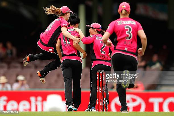 Marizanne Kapp of the Sixers celebrates with team mates after claiming the wicket of Stafanie Taylor of the Thunder during the Women's Big Bash...