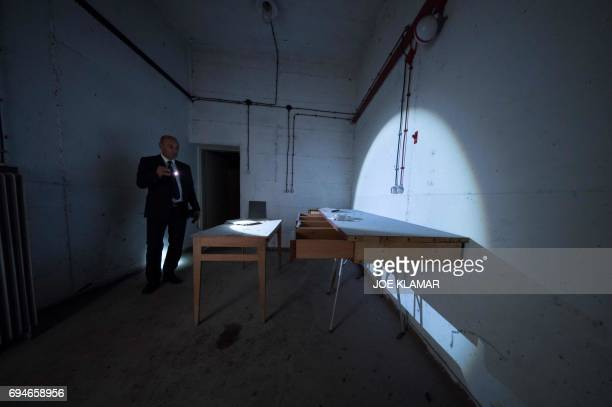 Marjan Batagelj owner of the hotel Jama shows an interior of recently discovered fullyequipped surveillance facility in a secret room located at...
