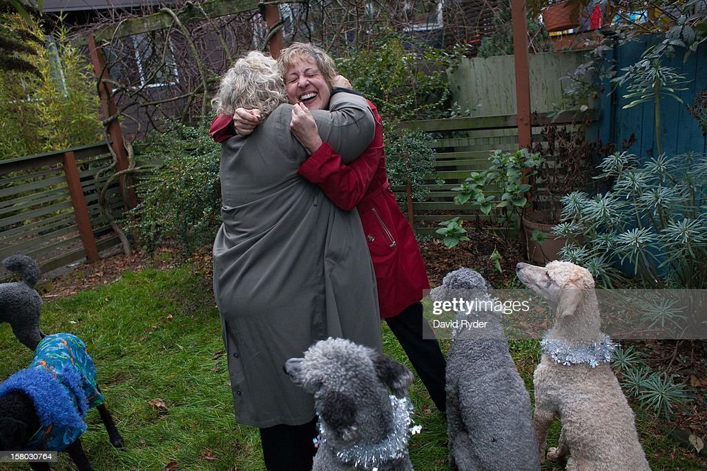 Marji Lynn, right, and Sue Hopkins embrace before heading to City Hall to get married on the morning of December 9, 2012 in Seattle, Washington. The two are poodle enthusiasts and are surrounded by the five poodles of a close friend. Today is the first day that same-sex couples can legally wed in Washington state.