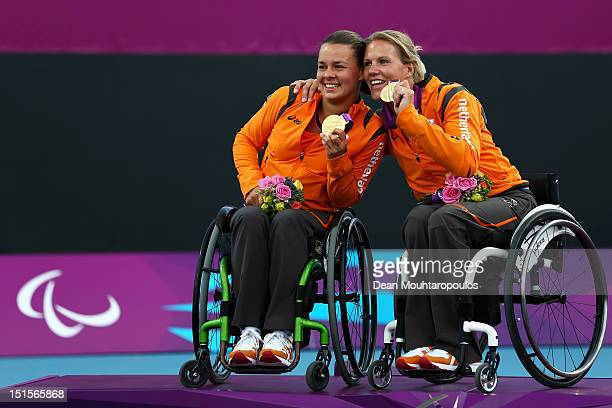 Marjolein Buis and Esther Vergeer of Netherlands celebrate winning the Gold medal against Jiske Griffioen and Aniek Van Koot of Netherlands in the...