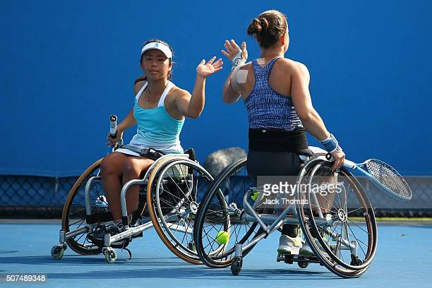 Marjolein Buis of the Netherlands and Yui Kamiji of Japan compete in the Women's Wheelchair Doubles Final match against Jiske Griffioen of...