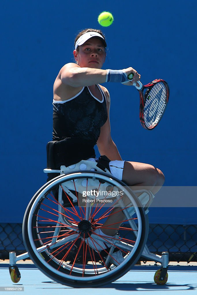 Marjolein Buis of the Netherlands plays a backhand in her second round match against Aniek Van Koot of the Netherlands during the 2013 Australian Open Wheelchair Championships at Melbourne Park on January 24, 2013 in Melbourne, Australia.