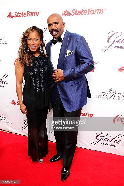 Marjorie and Steve Harvey attend the 2014 Steve Marjorie Harvey Foundation Gala presented by CocaCola at the Hilton Chicago on May 3 2014 in Chicago...
