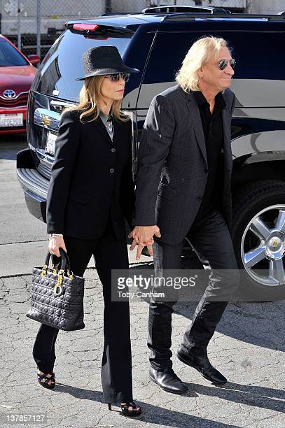 Marjorie Bach and Joe Walsh arrive for the funeral of singer Etta James in the City Of Refuge Church on January 28 2012 in Gardena California