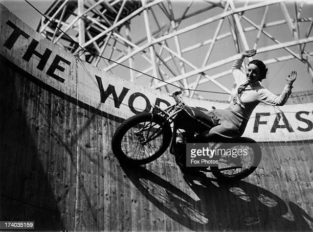 Marjorie Dare riding hands free around 'The Wall of Death' sideshow at the Kursaal amusement park in Southend Essex 1938