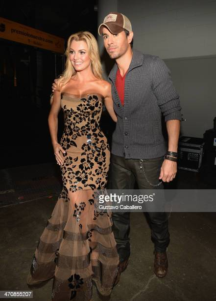 Marjorie de Sousa and Enrique Iglesias pose backstage at Premio Lo Nuestro a la Musica Latina 2014 at American Airlines Arena on February 20 2014 in...
