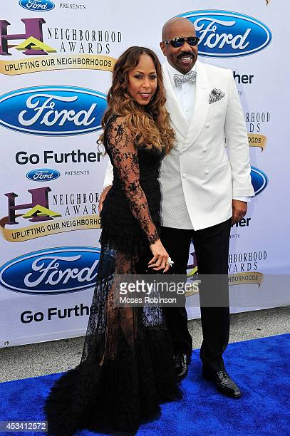 Marjorie Harvey and Steve Harvey attend the 2014 Ford Neighborhood Awards Hosted By Steve Harvey at the Phillips Arena on August 9 2014 in Atlanta...