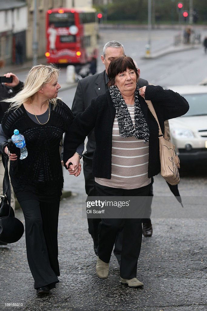 Marjorie Kidd (R), the mother of former stuntman Eddie Kidd, arrives at Brighton Magistrates Court to attend the trail of Samantha Kidd, the estranged wife of Eddie Kidd, who is charged with assaulting him on January 9, 2013 in Brighton, England. Samantha Kidd is accused of assaulting Mr Kidd, who is paralysed and brain-damaged after a stunt went wrong in August 1996, six times over a period of four months from July to October 2012.