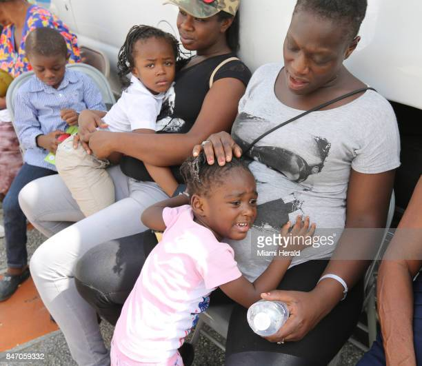 Marjorie Metellus tries to comfort her 3yearold daughter Geneviene as she and her new friend Chantrell Manning and her kids Taliyah 4 years old and...