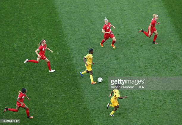 Marjory Nyaumwe of Zimbabwe runs with the ball during the Women's First Round Group F match between Canada and Zimbabwe on Day 1 of the Rio 2016...