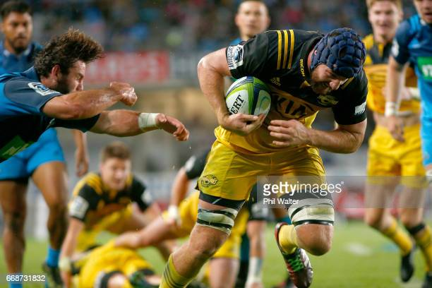 Mark Abbott of the Hiurricanes scores a try during the round eight Super Rugby match between the Blues and the Highlanders at Eden Park on April 15...
